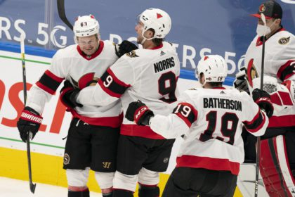 Ottawa Senators right winger Evgenii Dadonov(63) celebrates with teammates after his game-winning goal to defeat the Toronto Maple Leafs in overtime during an NHL hockey game, Monday, Feb. 15, 2021, in Toronto, Canada. (AP Photo/Peter Power)