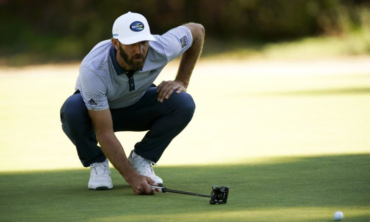 Dustin Johnson lines up his putt on the 13th hole during the final round of the Genesis Invitational golf tournament at Riviera Country Club, Sunday, Feb. 21, 2021, in the Pacific Palisades area of Los Angeles. (AP Photo/Ryan Kang)