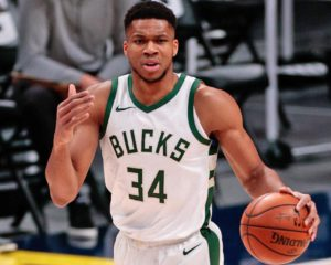 Feb 8, 2021; Denver, Colorado, USA; Milwaukee Bucks forward Giannis Antetokounmpo (34) motions as he dribbles the ball up court in the first quarter against the Denver Nuggets at Ball Arena. Mandatory Credit: Isaiah J. Downing-USA TODAY Sports