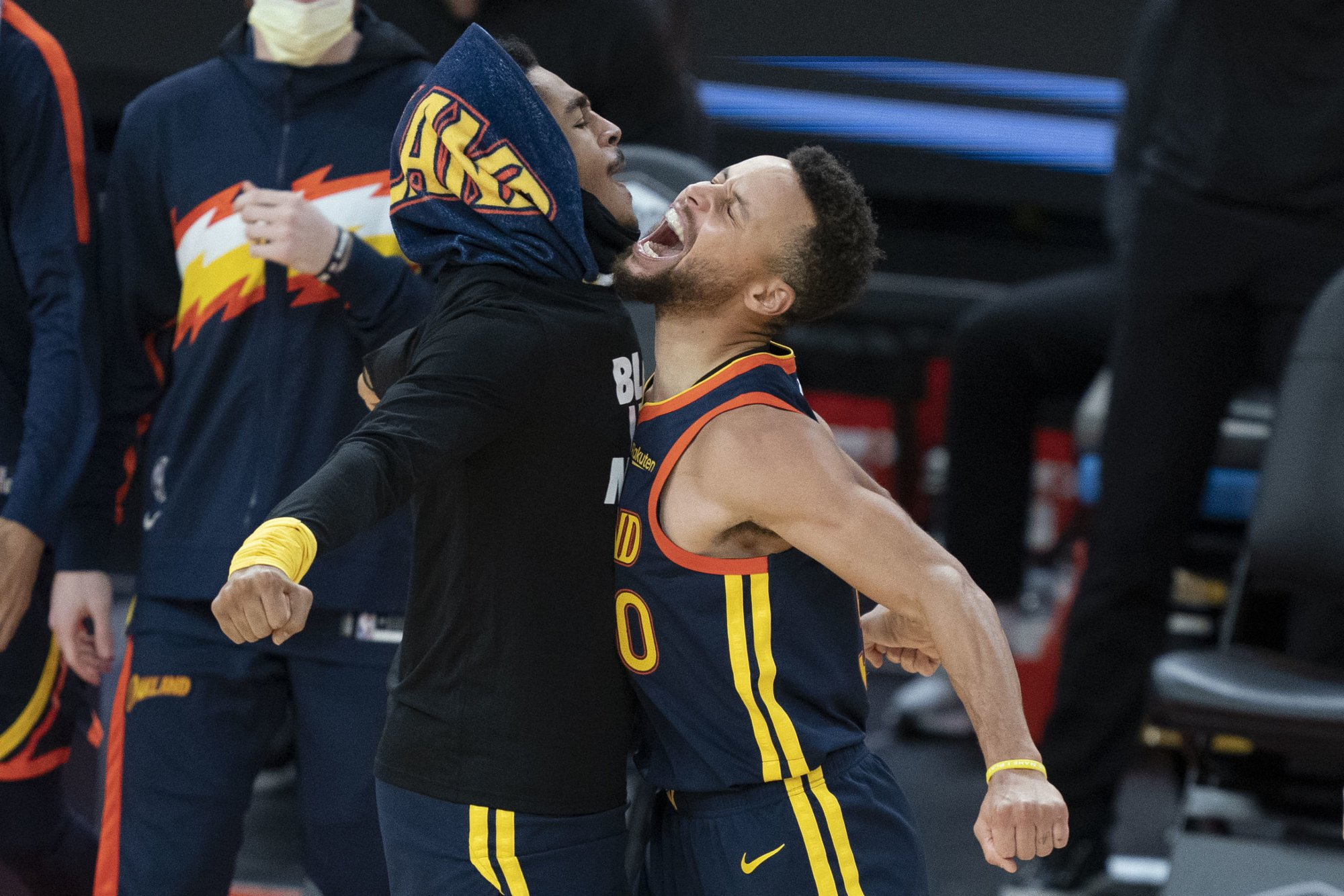 January 25, 2021; San Francisco, California, USA; Golden State Warriors guard Jordan Poole (left) celebrates with guard Stephen Curry (right) against the Minnesota Timberwolves during the fourth quarter at Chase Center. Mandatory Credit: Kyle Terada-USA TODAY Sports