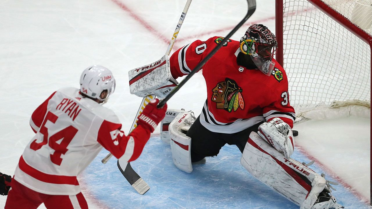 Feb 27, 2021; Chicago, Illinois, USA; Detroit Red Wings right wing Bobby Ryan (54) scores a goal past Chicago Blackhawks goaltender Malcolm Subban (30) during the first period at the United Center. Mandatory Credit: Dennis Wierzbicki-USA TODAY Sports