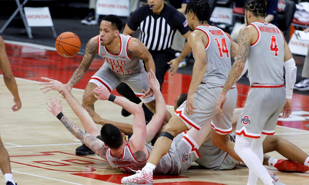 Feb 21, 2021; Columbus, Ohio, USA;  Ohio State Buckeyes guard CJ Walker (13) fights for the loose ball during the second half against the Michigan Wolverines at Value City Arena. Mandatory Credit: Joseph Maiorana-USA TODAY Sports
