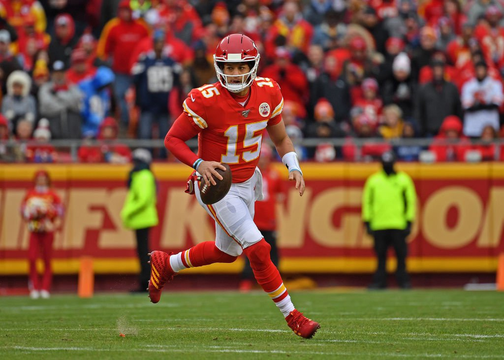 KANSAS CITY, MO – DECEMBER 29:  Quarterback Patrick Mahomes #15 of the Kansas City Chiefs rolls out against the Los Angeles Chargers during the first half at Arrowhead Stadium on December 29, 2019 in Kansas City, Missouri. (Photo by Peter G. Aiken/Getty Images)