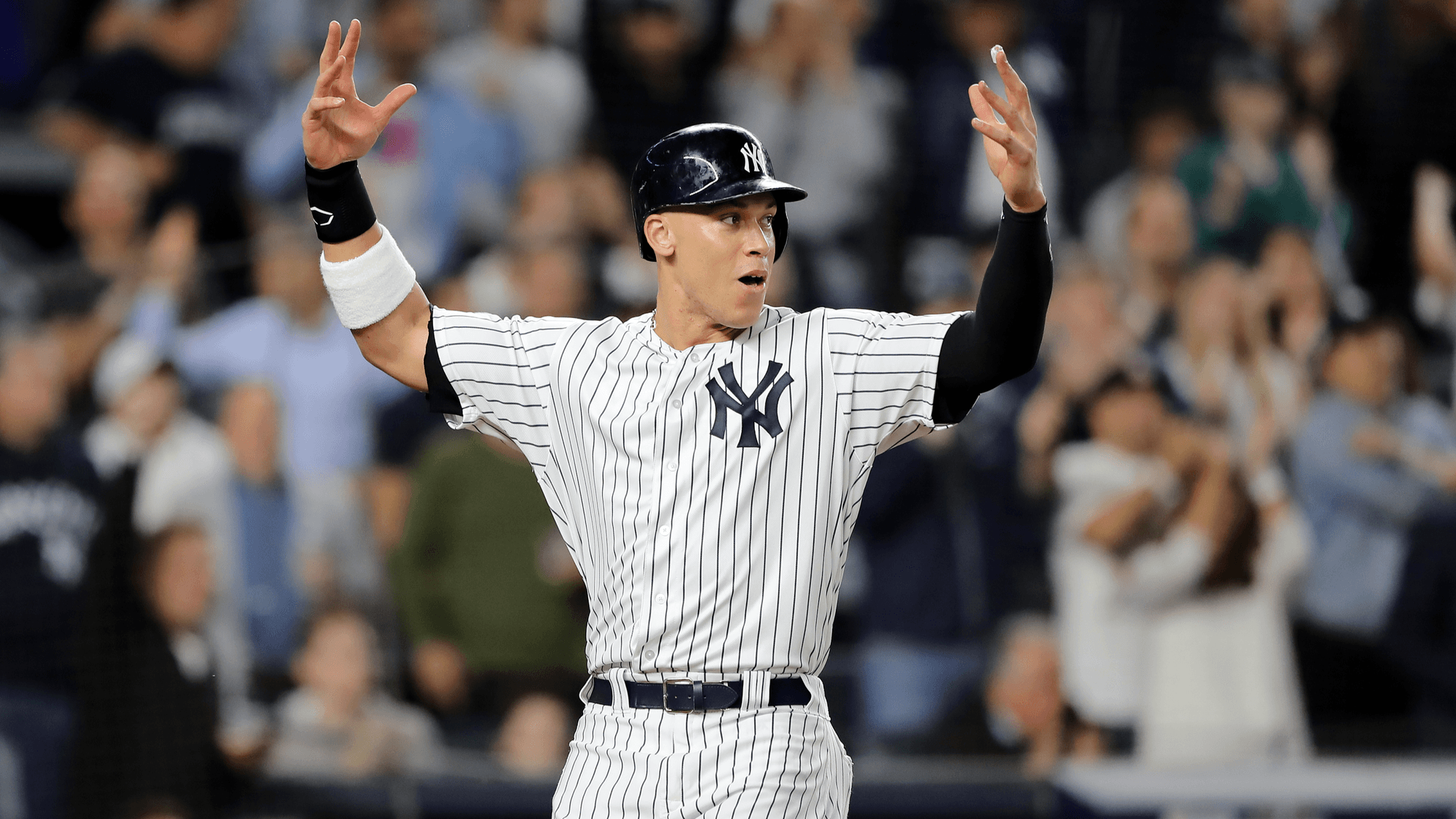 NEW YORK, NEW YORK – OCTOBER 03:  Aaron Judge #99 of the New York Yankees celebrates after scoring a run off of a double hit by Aaron Hicks #31 during the sixth inning against the Oakland Athletics in the American League Wild Card Game at Yankee Stadium on October 03, 2018 in the Bronx borough of New York City. (Photo by Elsa/Getty Images)