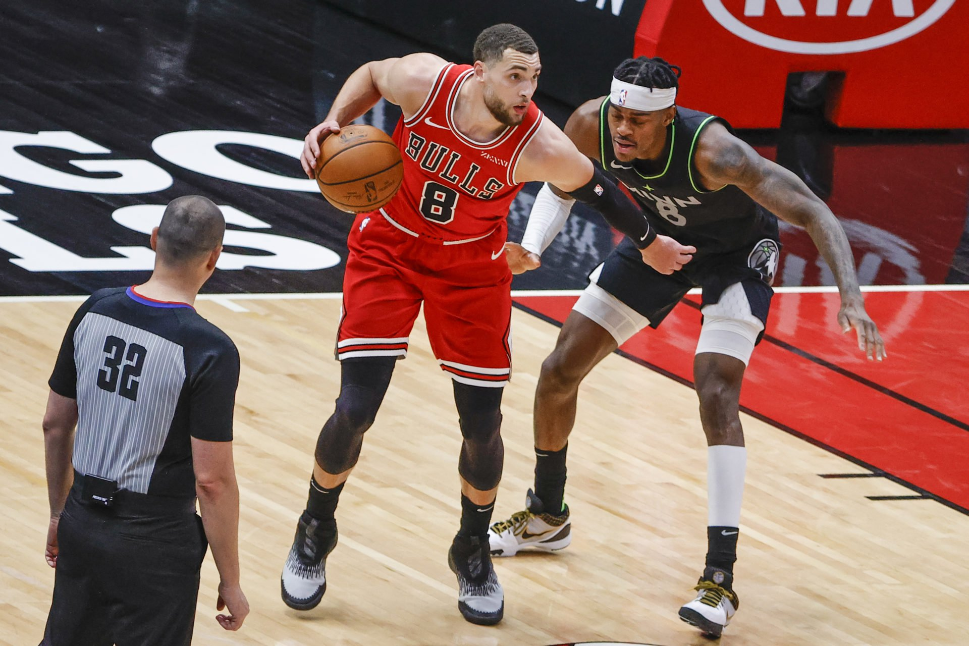 Feb 24, 2021; Chicago, Illinois, USA; Chicago Bulls guard Zach LaVine (8) is defended by Minnesota Timberwolves forward Jarred Vanderbilt (8) during the second half of an NBA game at United Center. Mandatory Credit: Kamil Krzaczynski-USA TODAY Sports