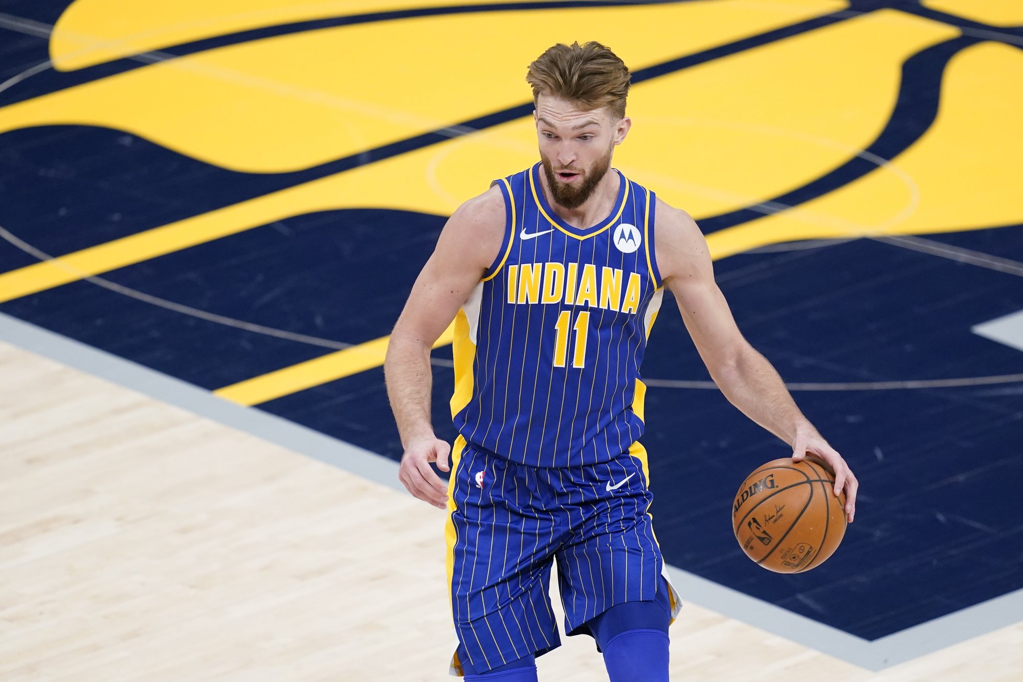Indiana Pacers forward Domantas Sabonis (11) dribbles during the first half of an NBA basketball game against the Denver Nuggets, Thursday, March 4, 2021, in Indianapolis. (AP Photo/Darron Cummings)