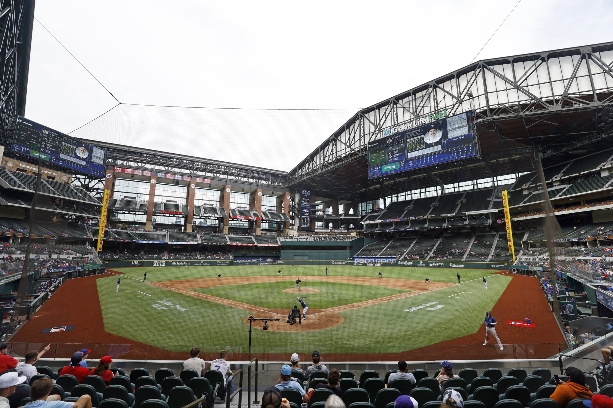 The Texas Rangers and the Milwaukee Brewers play a preseason baseball game at Globe Life Field, Tuesday, March 30, 2021, in Arlington, Texas. (AP Photo/Michael Ainsworth)