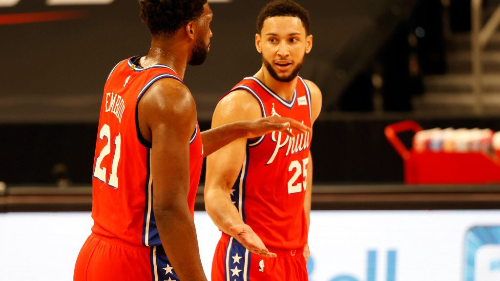 Feb 21, 2021; Tampa, Florida, USA; Philadelphia 76ers center Joel Embiid (21) and guard Ben Simmons (25) talk against the Toronto Raptors during the first quarter at Amalie Arena. Mandatory Credit: Kim Klement-USA TODAY Sports