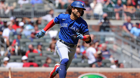 ATLANTA, GEORGIA – MAY 13:  Bo Bichette #11 of the Toronto Blue Jays runs down the first base line after hitting a two-RBI double in the ninth inning against the Atlanta Braves at Truist Park on May 13, 2021 in Atlanta, Georgia. (Photo by Kevin C. Cox/Getty Images)