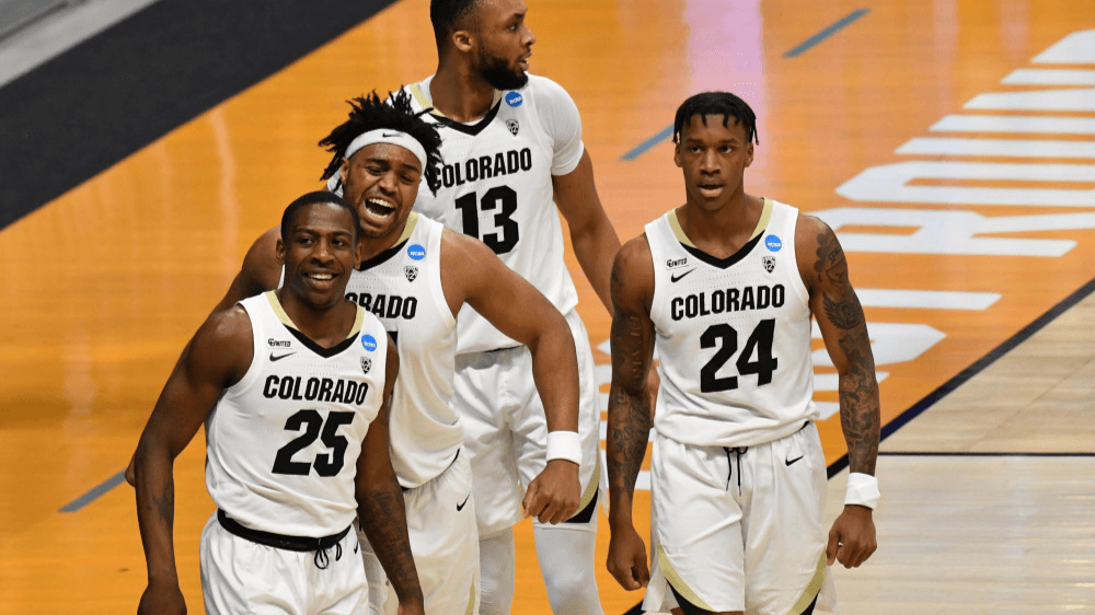 Mar 20, 2021; Indianapolis, Indiana, USA;  Colorado Buffaloes guard McKinley Wright IV (25) celebrates with forward Evan Battey (21) after making a basket against the Georgetown Hoyas during the first round of the 2021 NCAA Tournament at Hinkle Fieldhouse. Mandatory Credit: Patrick Gorski-USA TODAY Sports