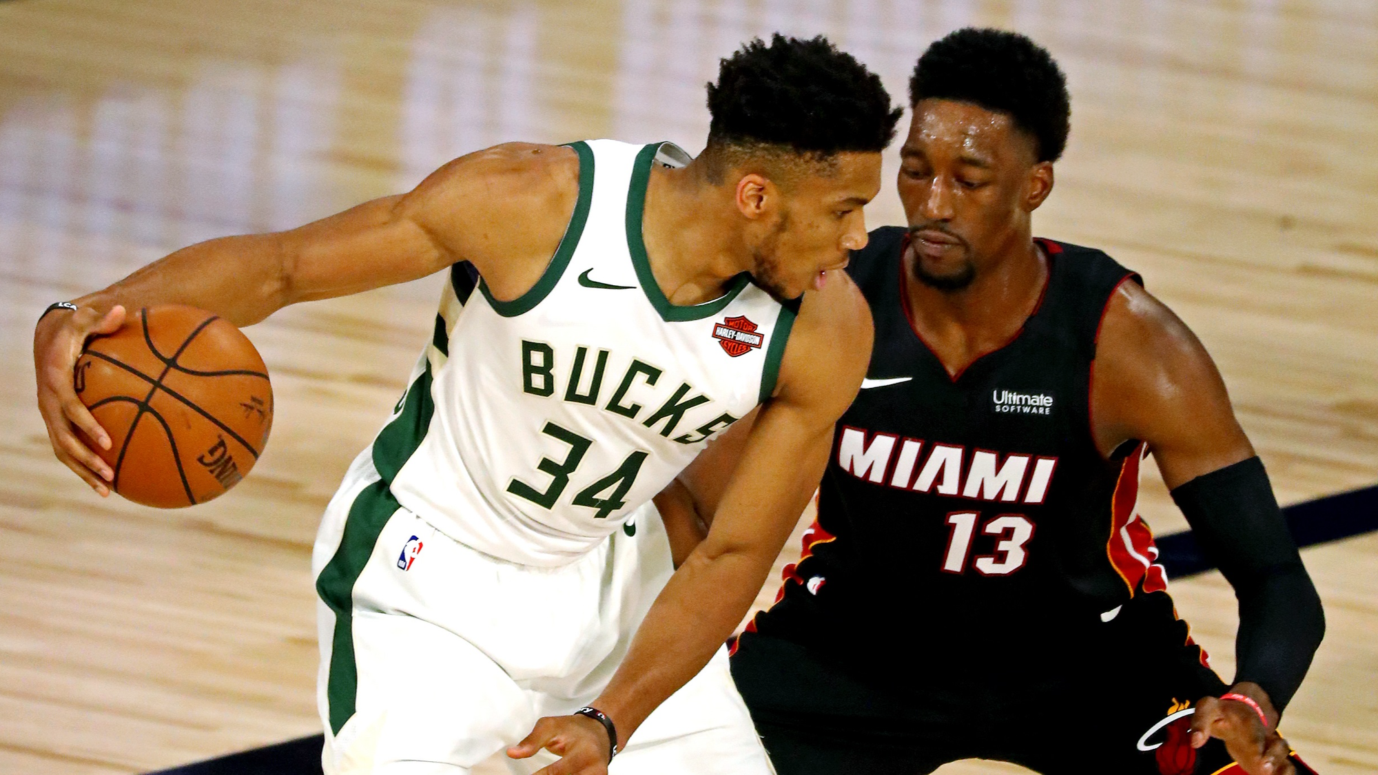 Sep 4, 2020; Lake Buena Vista, Florida, USA; Milwaukee Bucks forward Giannis Antetokounmpo (34) handles the ball against Miami Heat forward Bam Adebayo (13) during the first quarter in game three of the second round of the 2020 NBA Playoffs at ESPN Wide World of Sports Complex. Mandatory Credit: Kim Klement-USA TODAY Sports