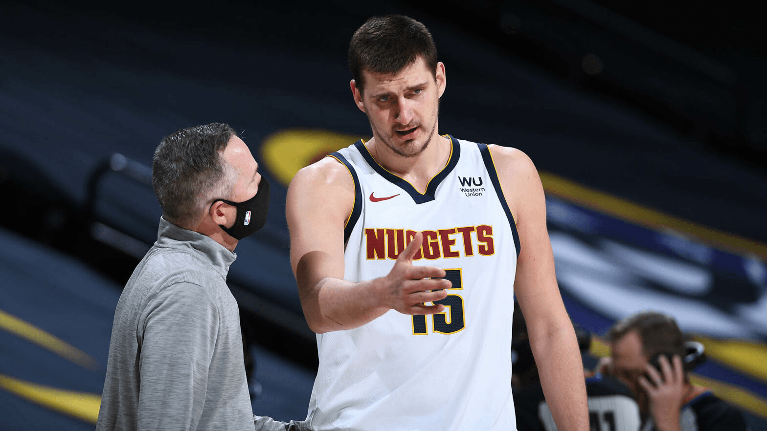 DENVER, CO – DECEMBER 28: Head Coach Michael Malone and Nikola Jokic #15 of the Denver Nuggets talk during the game against the Houston Rockets on December 28, 2020 at the Pepsi Center in Denver, Colorado. NOTE TO USER: User expressly acknowledges and agrees that, by downloading and/or using this Photograph, user is consenting to the terms and conditions of the Getty Images License Agreement. Mandatory Copyright Notice: Copyright 2020 NBAE (Photo by Garrett Ellwood/NBAE via Getty Images)
